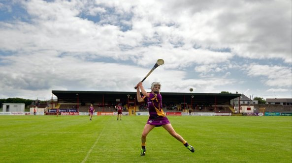 Wexford's Kate Kelly strikes the sliotar during their win over Galway in the Senior Camogie Championship in Kenny Park