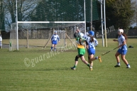 Cailin Fitzgerald (O) and Aoife Shanahan (W) try to grab the ball