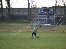 Aoife Sweeney pucks out the ball