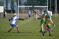 Ciara Brennan (O) gets the ball away from Kate McMahon (W)