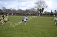 Aisling Power passes the ball in