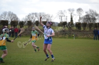 Anne Corcoran catches the ball from the sky