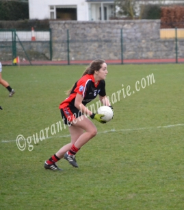 Michelle (TCD) looks for a pass