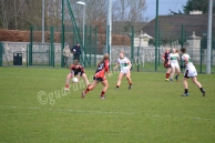 Michelle (TCD) catches the ball to pass to team mate Catriona Smith (TCD)