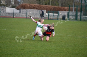 Elaine Ware (ITC) and Aisling Reynolds (TCD) collide