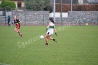 Grace Clifford kicks the ball