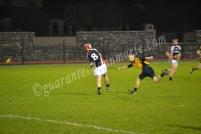 Johnny Tallon drives a ball into the forwards