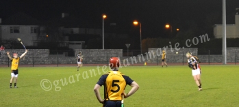 Liam Gachan (DCU) watches on as Maurice Sexton hits a free (ITC)