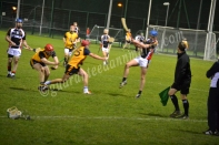 Tommy Gallagher (ITC) gets the ball away