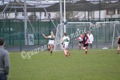 Evie Casey kicks at goal