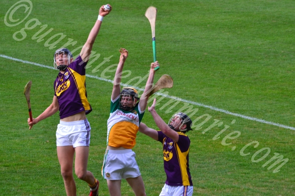 Jack O'Connor leaps the highest to grab the ball