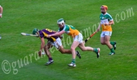 Cathal Mahon Offaly and Conor Devitt Wexford contest a ball