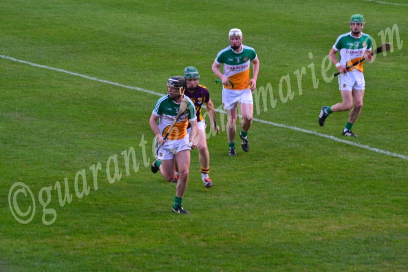 Ger Crowe Offaly comes out with the ball