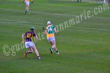 Emmet Nolan Offaly tracks back to defend as James Cash tries to tackle