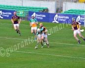 Emmet Nolan Offaly wins the ball depsite Wexford attempts