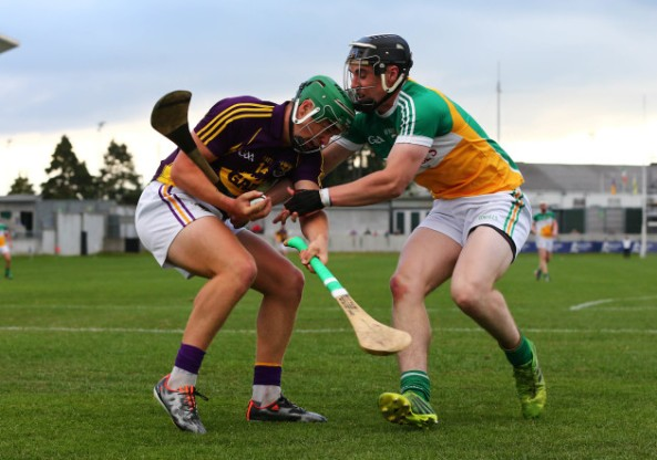 EirGrid Leinster Under 21 Hurling Championship Semi-Final, O'Connor Park, Tullamore, Co. Offaly 24/6/2015 Offaly vs Wexford Offaly's Cillian Kiely tackles Conor McDonald of Wexford Mandatory Credit ©INPHO/Cathal Noonan