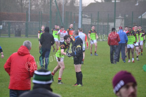Mark Sherry shaking hands with Kildare referee F Barry after their Sigerson win over IT Sligo