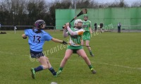 Aisling Brennan keeps her eyes on the ball as Julia Buckley hooks
