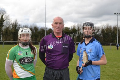 Captains Aisling Brennan (Offaly), Referee John McDonagh, Alex Griffen (Dublin) before the All-Ireland Minor A championship round 3 game